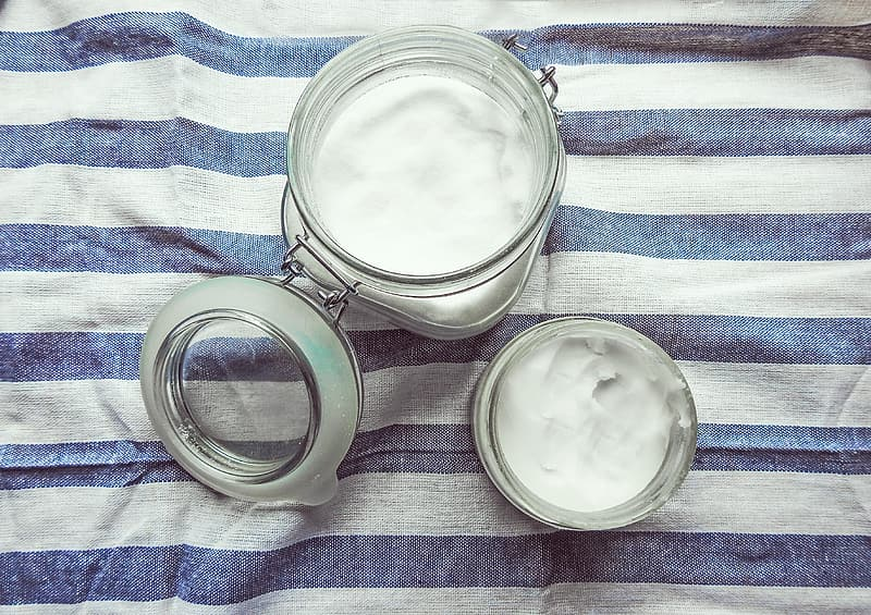 Two clear glass mason jars with creams