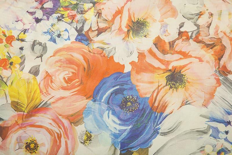 Close up photo of blue and orange floral painting