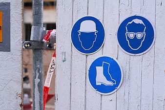 Three blue and white signages