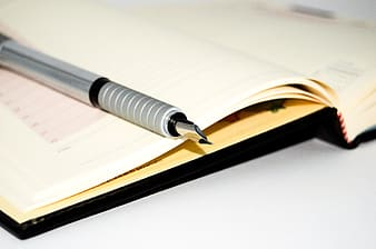 Fountain pen on opened notebook