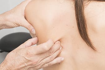 Woman holding her breast in close up photography