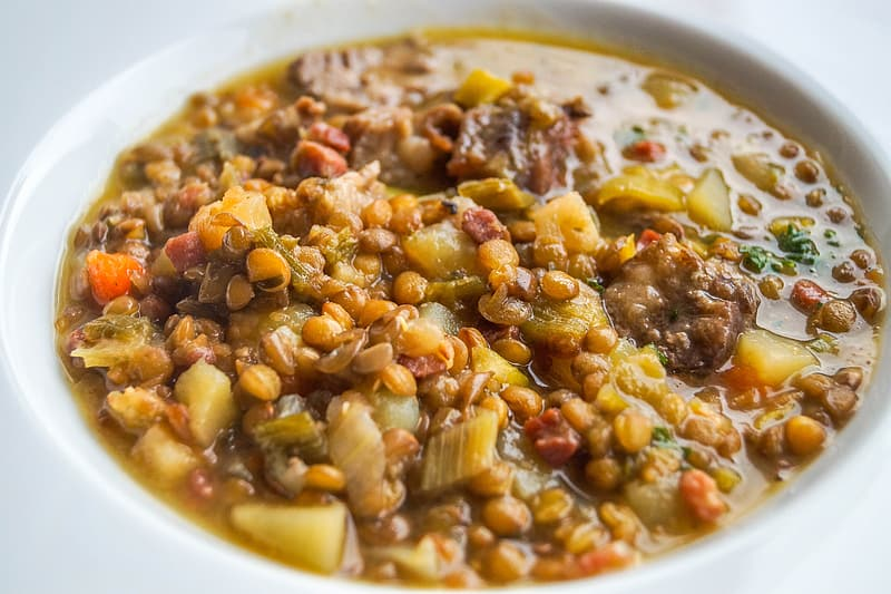 Sauteed meat dish with beans and vegetables in bowl