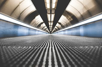 Black and white tunnel with blue lights