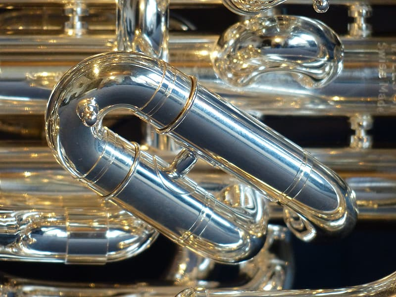 Gold trumpet on black surface