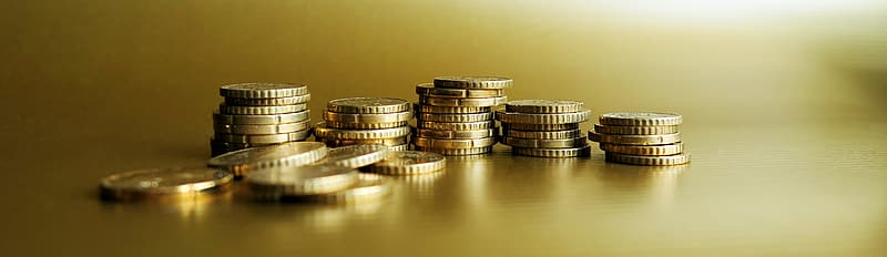 Gold-colored coins selective focus phot o