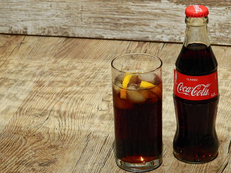 Coca-Cola soda bottle and drinking glass