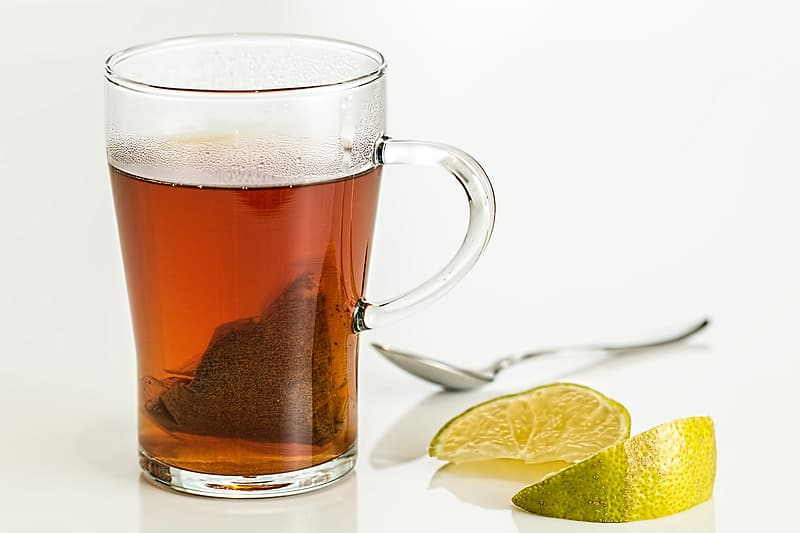 Still life photography of clear glass mug filled with brown liquid