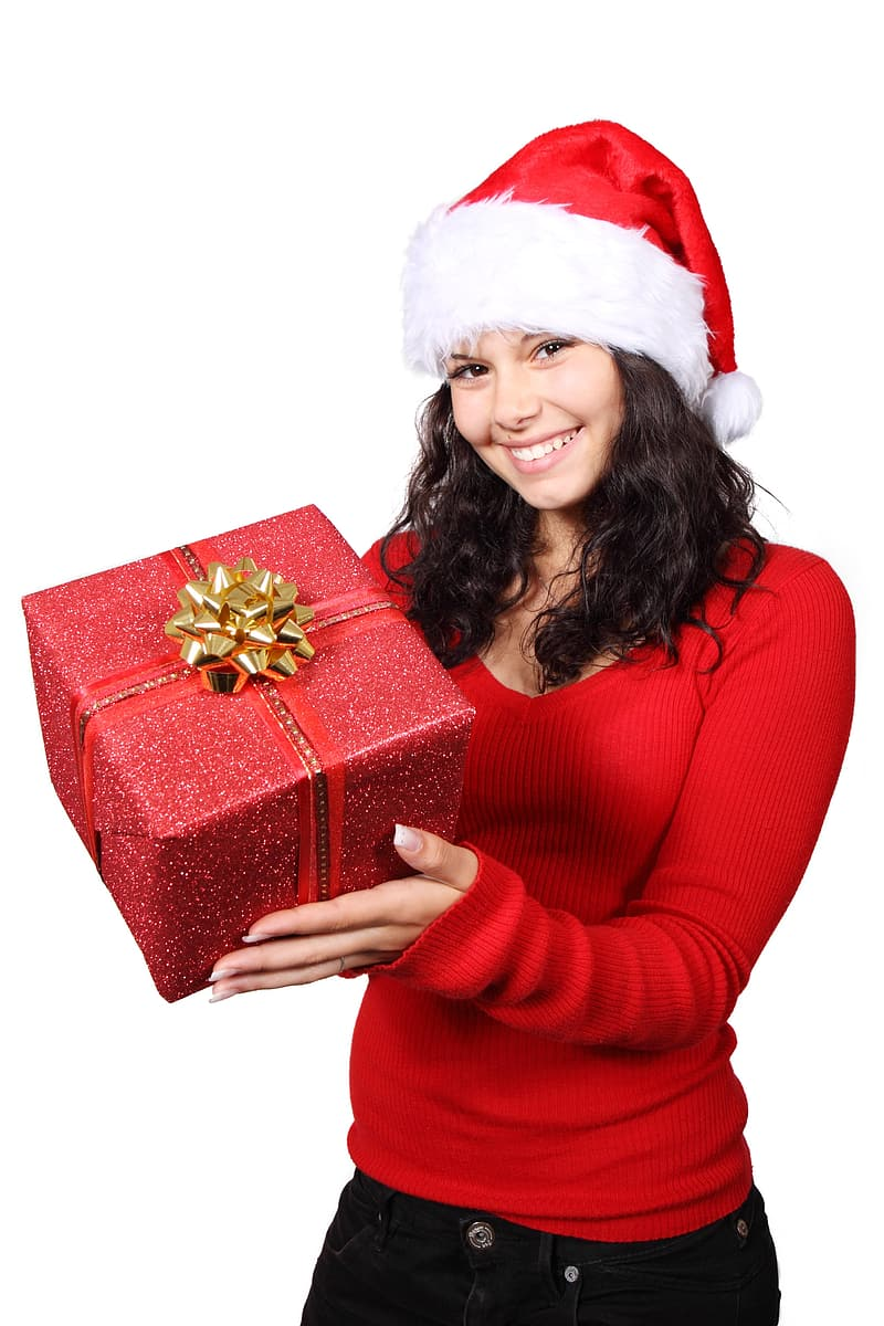 Woman in red long sleeve shirt holding red gift box