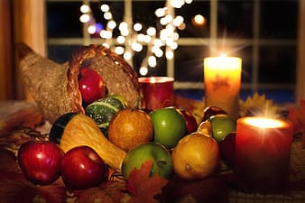 Green and red apples and brown wicker basket
