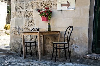 Brown and black 3-piece bistro set outside during daytime