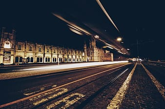 Train rail near building during night time
