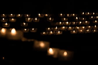 Low light photography of candles