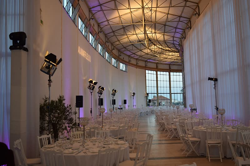 White table clothes with chairs set inside dome building
