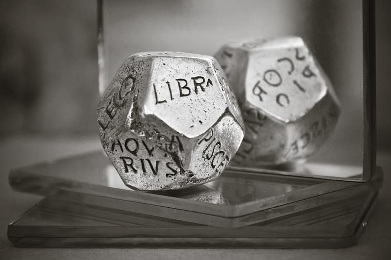 Greyscale photo of silver die