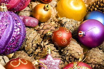 Yellow and pink baubles on brown and pink textile