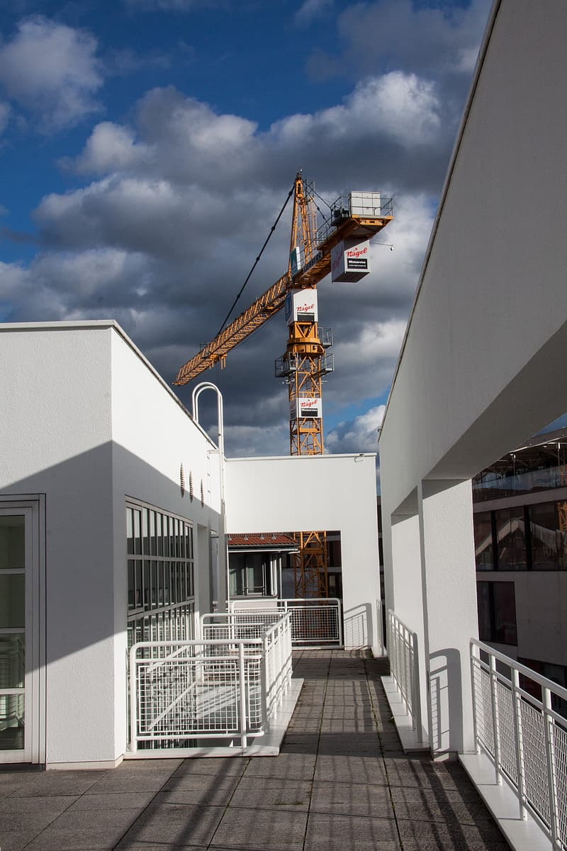 White concrete building with tower crane