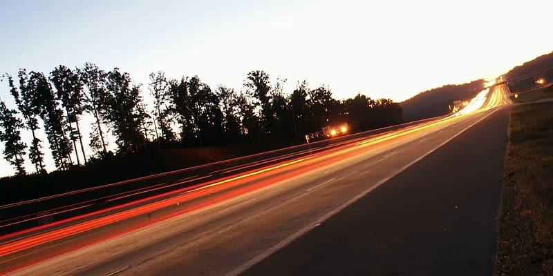 Time lapse photography of vehicle on road during daytime