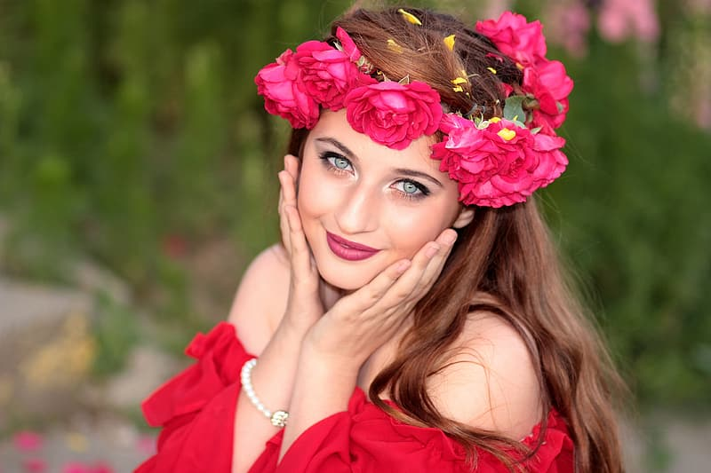 Woman wears red off-shoulder shirt with red flower headdress
