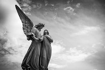 Female angel and woman statue