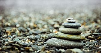 Shallow photography of stone stacking