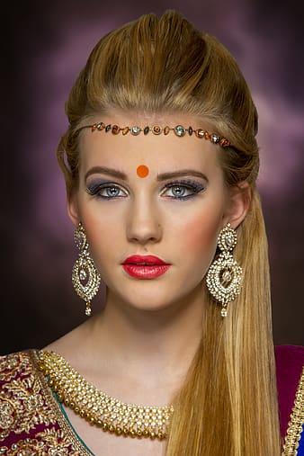 Woman wearing gold-colored jewelries