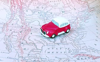 Red and white car scale model on map