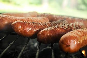 Sausages grilled on black grill