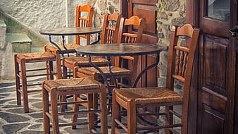 Two round wooden tables with chairs