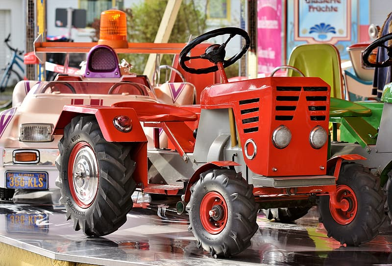 Red ride-on tractor on table