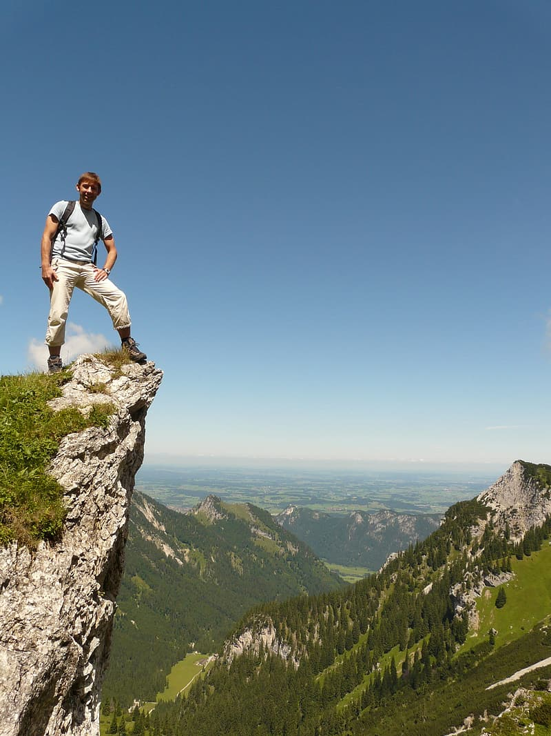 Man standing on edge of the cliff
