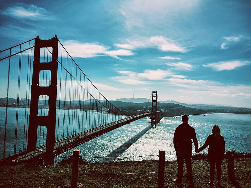 Man and woman standing on bridge during daytime