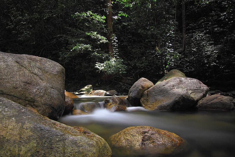 Time lapse photography of river surrounded with rocks and trees