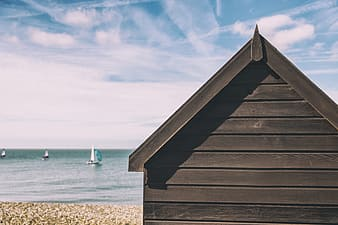 Summer beach hut house on the coast on a sunny summer day