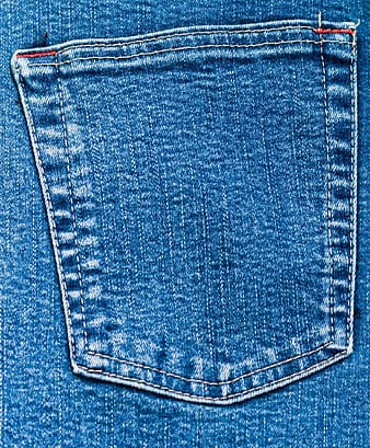 Closeup photo of blue denim bottoms pocket
