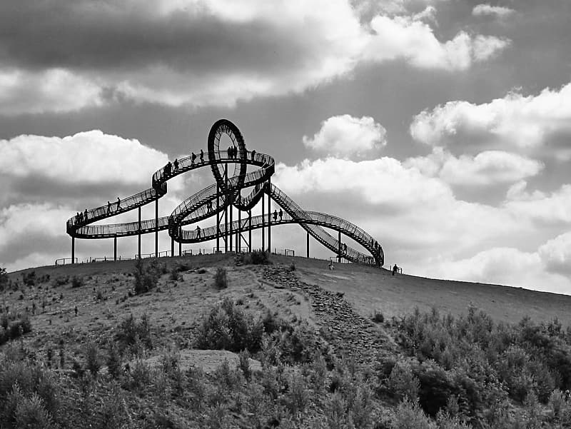 Grayscale photo of roller coaster trail