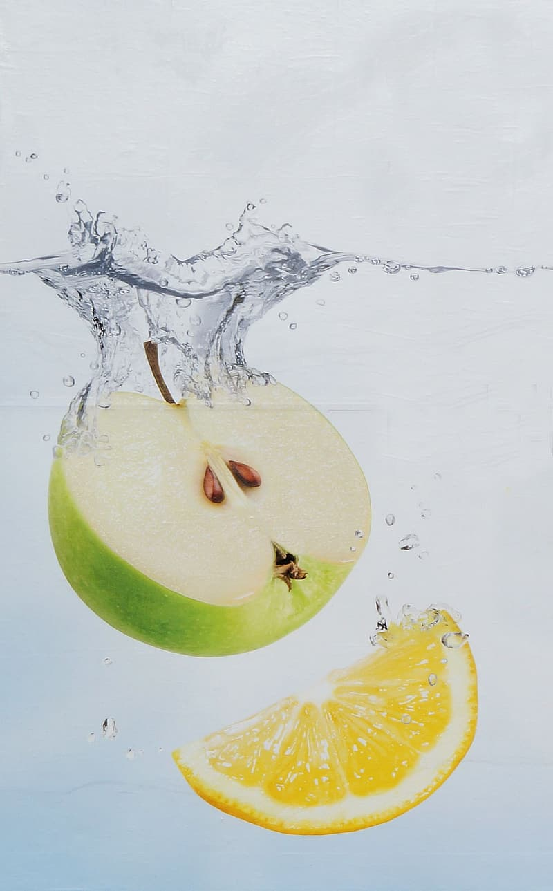 Sliced granny smith apple and lemon fruit in water
