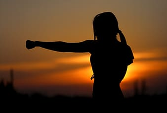 Silhouette of female punching photo