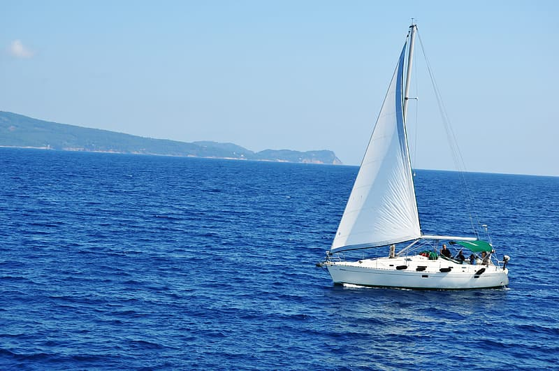 Photo of white sailboat on blue sea during daytime
