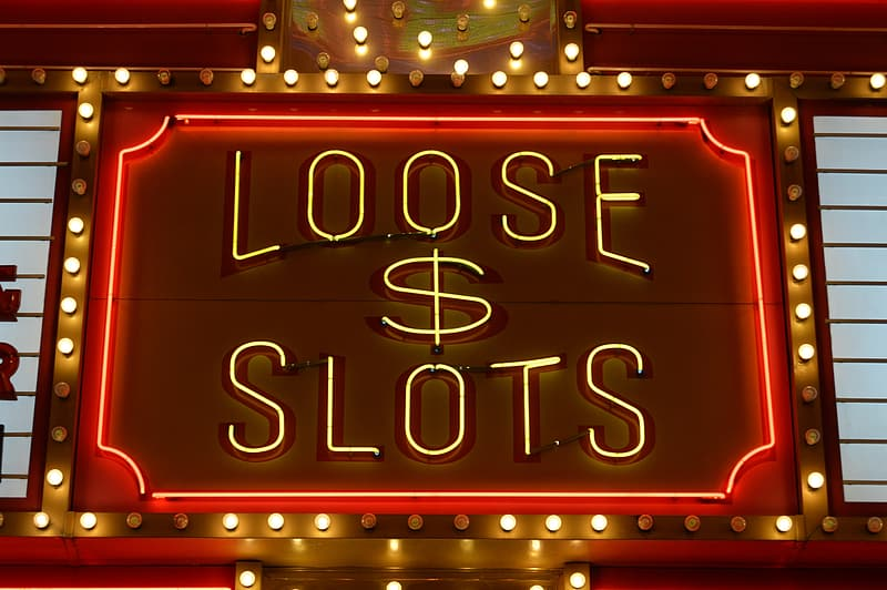 Red and brown LED light Loose $ Slots signage