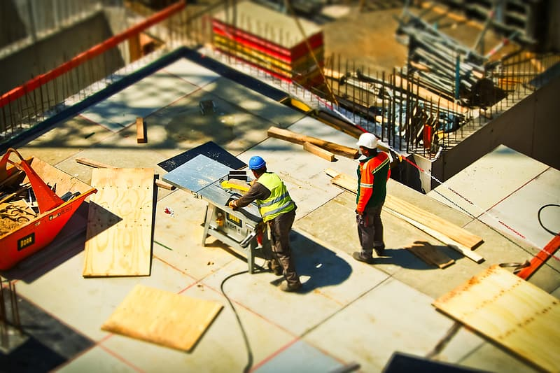 Two men working in construction during daytime