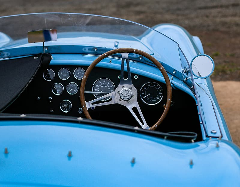 Close-up photo of blue convertible coupe at daytime