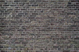 Black and brown brick wall