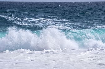 Ocean waves crashing on shore during daytime