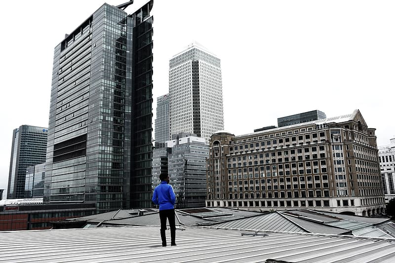 Man standing on building rooftop