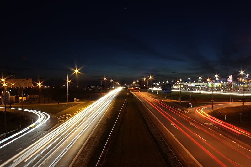 Time-lapse photography of car lights on road