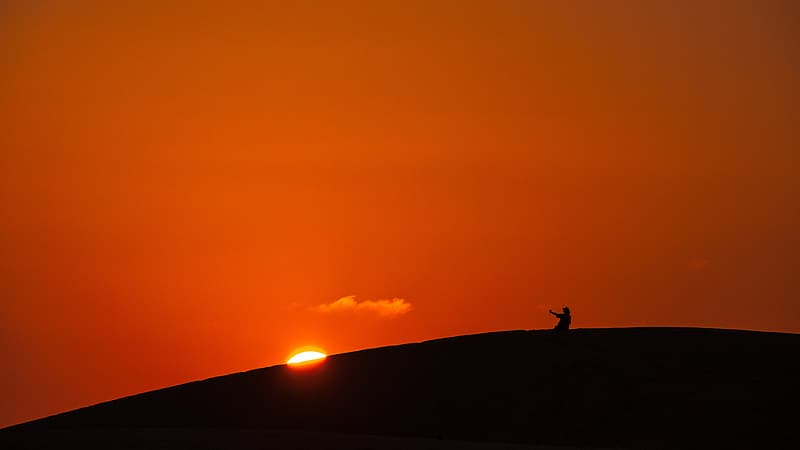 Silhouette of person in the mountain
