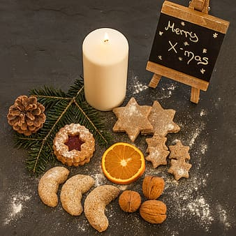 Flat lay photography of baked pastries placed near pillar candle