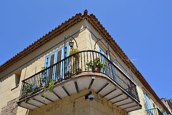 Low-angle photo of house terrace
