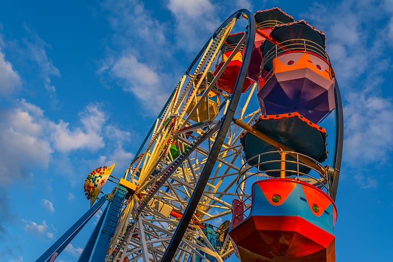 Low angle photography of red, yellow, and gray Ferris wheel
