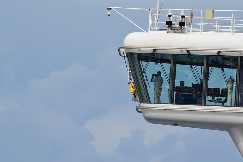 White and black cable car under white sky during daytime